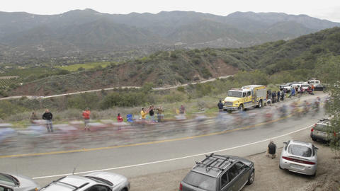 Peloton in slow motion during a time lapse of the 2008 Tour of California bike race passing over Den Footage