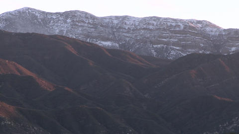 Close-up pan of the snow covered Topatopa Mountain above Ojai, California Footage
