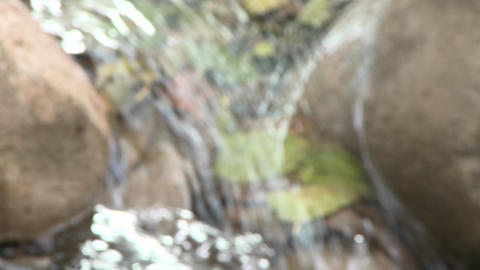 Close up rack focus of waterfall in Wheeler Springs above Ojai, California Footage