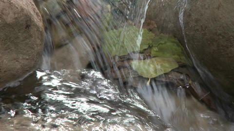 Close up tilt down a waterfall in Wheeler Springs above... Stock Video Footage