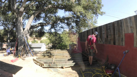 Time lapse of two men building a deck in two days in Oak View, California Footage