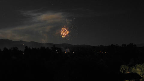 Zoom in time lapse of Fourth of July fireworks in Ojai,... Stock Video Footage