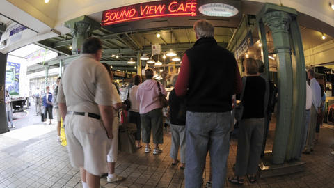 Time lapse of people shopping at Pike Place Market in downtown Seattle, Washington Footage