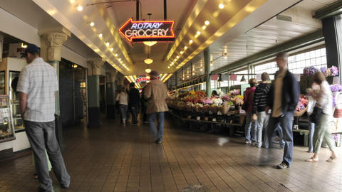 Zoom out time lapse of people walking at Pike Place... Stock Video Footage