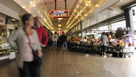 Zoom out time lapse of people walking at Pike Place Market in downtown Seattle, Washington Footage