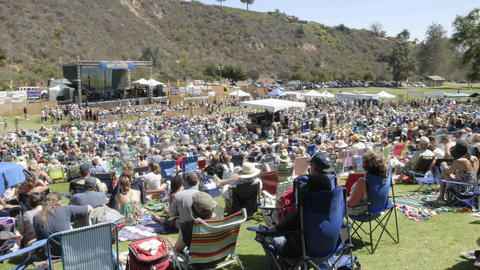 Full day time lapse of a crowd at an outdoor concert in Ventura, California Footage
