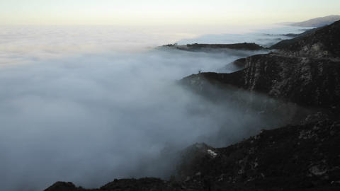 Time lapse of coastal fog at sunrise along the Santa Ynez... Stock Video Footage