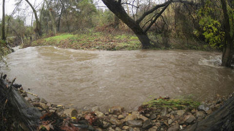 Time lapse from three angles of San Antonio Creek flooding during a storm in Ojai, California Footage