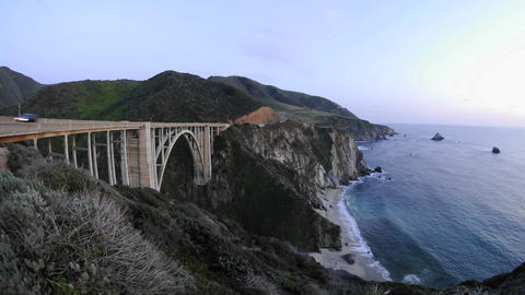 Time lapse at dusk on the historic Bixby Creek Bridge and the Big Sur Coast in Big Sur, California Footage