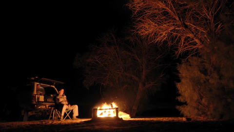 Night time lapse of people enjoying a campfire in Mojave... Stock Video Footage