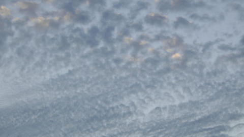 Time lapse of slow moving altocumulus clouds over... Stock Video Footage