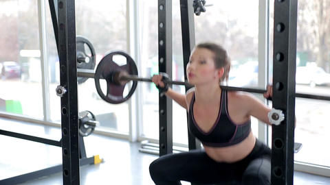 Fit girl with sexy body doing barbell workout routine in gym, healthy lifestyle Footage