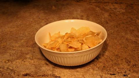Potato chips dropping into bowl P HD 6351 Live Action