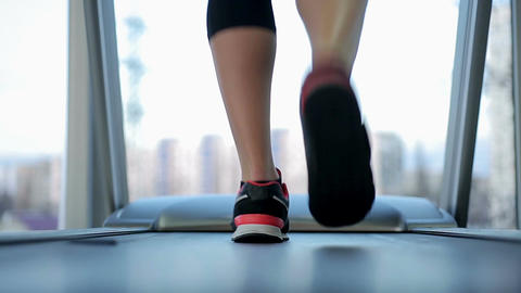 Legs of sportive woman walking and running on treadmill, healthy lifestyle Footage