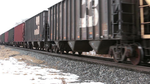 Railroad cars passing winter rural community HD 5031 Footage