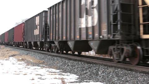 Railroad cars passing winter rural community HD 5031 Footage