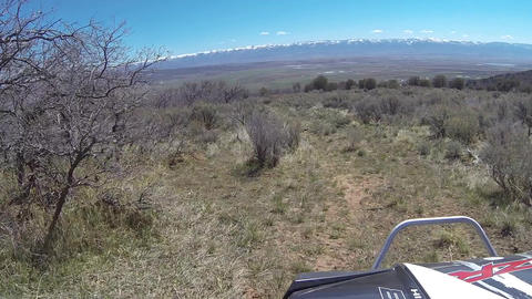 Recreation ride ATV high mountain trail over valley HD 341 Footage
