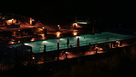 Resort night swimming pool and hot tubs HD 8596 Footage