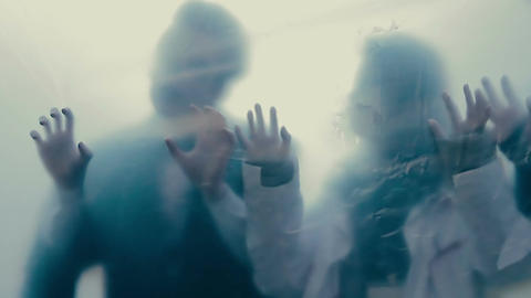 Human silhouettes behind transparent film, isolated infected people, lost souls Live Action
