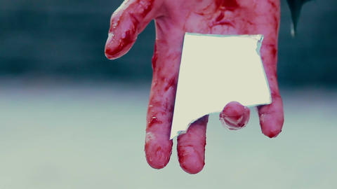 Bloody hand of suicider holding mirror chip, desperate person commits suicide Footage