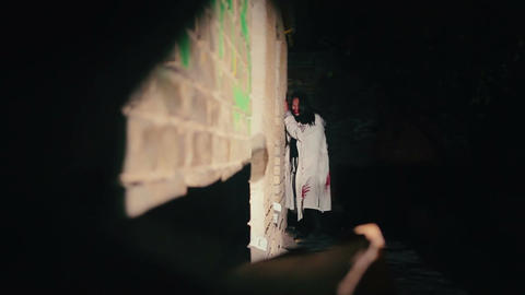 Point of view of person hiding in darkness from evil vampires, scary zombies Live Action