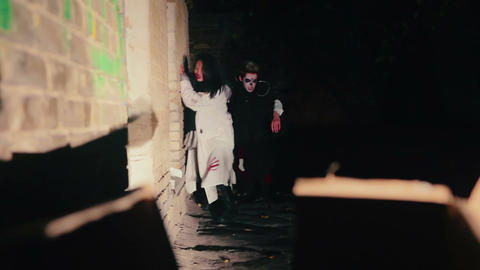 Scary male and female zombies sneaking through darkness, invasion of evil forces Live Action
