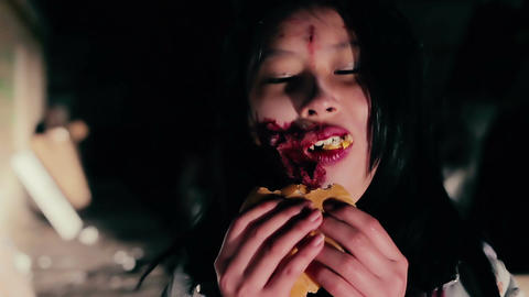 Fastfood addict female zombie eating burger, scary creature enjoying lunch time Live Action