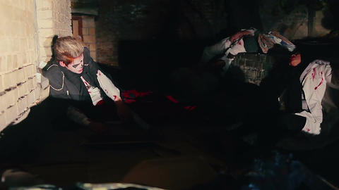 Human-beings waking up in debris after transformation into zombies, horror movie Live Action