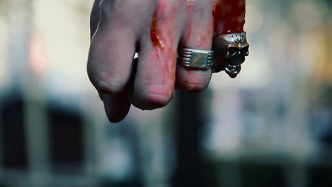 Man clenching fist fiercely, blood running down male hand, offering ritual Live Action