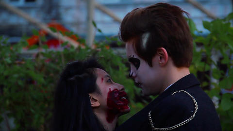 Young couple hugging, enjoying Halloween party, lovers talking to each other Live Action