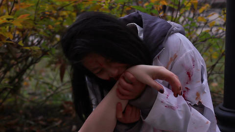 Hungry female vampire eating victim's dead body, monsters invasion, cannibalism Live Action