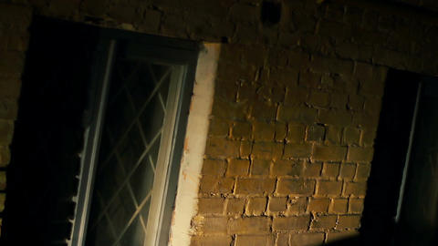 Horror film, dark shadow of killer beating victim with murder weapon, nightmare Footage