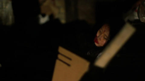 Dead woman lying in dark street, crime scene, unconscious victim of accident Live Action