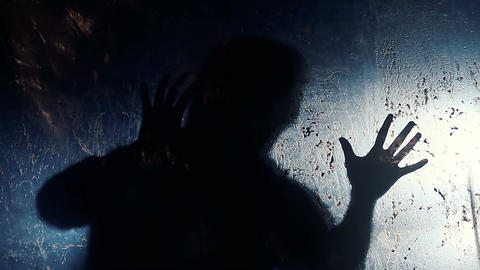 Scary gestures of strange human silhouette awaking fear, monster in darkness Footage