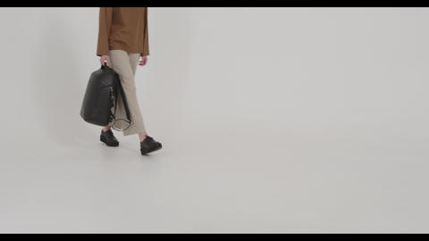 Fashion, girl model goes to the camera, fashionably dressed Live Action