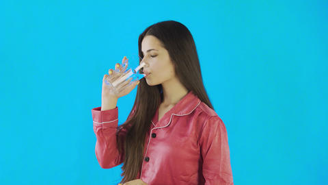 Caucasian teen female girl drinking glass of water. Young woman drinking water Live Action