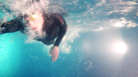 Underwater view professional Triathlete swim in pool. triathlon training action Live Action