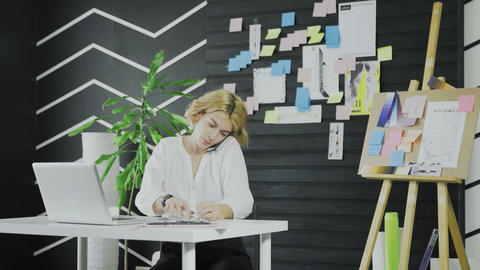 Attractive business woman talking on the cell phone and…, Live Action