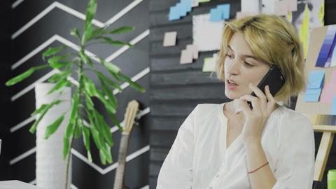 Portrait blond woman is using smartphone Live Action