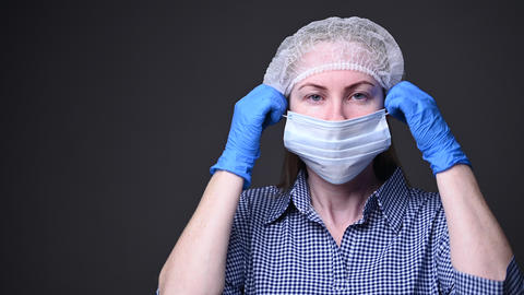 The girl takes off her protective medical mask. the covid-19 virus epidemic is Live Action