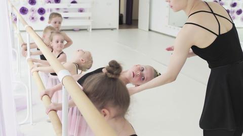 Little girls dance ballet. Children in ballet class. Little ballerinas and Live Action