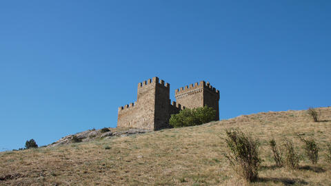 Old massonary of the medeival fortress tower in background of blue skies at top GIF