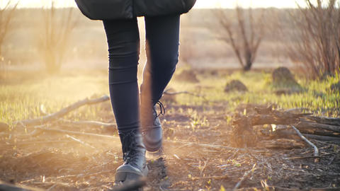 Cinematic shot in front of young girl strolling in trendy leggings and stylish Live Action