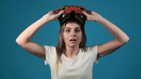 emotional girl takes off vr headset shocked by game scene Live Action