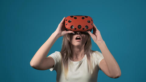 emotional girl takes off virtual reality headset shocked by game scene Live Action