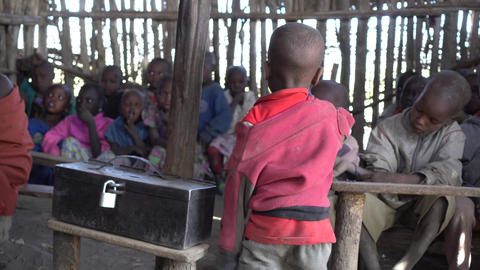 Children of Maasai Tribe Sitting in Class Room Hut in Dirty Clothes. Africa Live Action