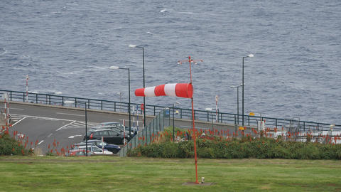 Zoom on Windsock at Airport of Madeira Funchal in Portugal 4K Ultra HD Live Action