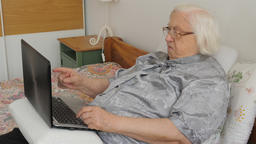 Senior woman learns how to use a laptop computer Live Action