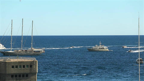 Time-lapse of movement in the sea at sunny day, View of motor and sail boat is Live Action