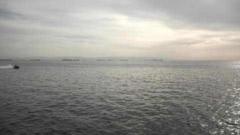 jet ski passing over the sea horizon Live Action